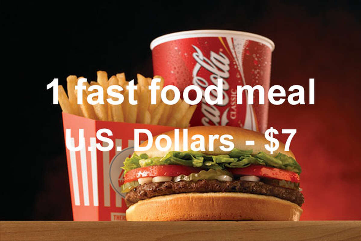 On average, a combo meal at a fast food restaurant costs $7 in U.S. dollars ...Source: Expatistan Cost of Living Index