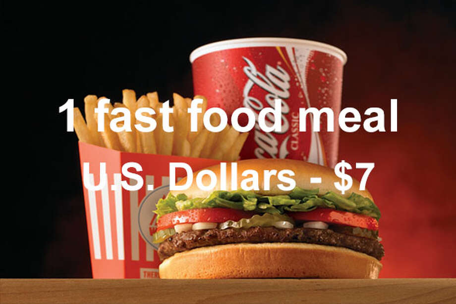 On average, a combo meal at a fast food restaurant costs $7 in U.S. dollars ...Source: Expatistan Cost of Living Index Photo: Whataburger / 2007 Getty Images
