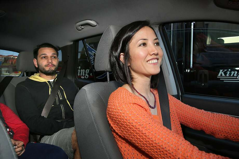 Driver and veteran Kathy Allen picks up UberPool customer Erick Espinosa in San Francisco. Uber will now give drivers extra money for each pickup on a Pool trip. Compensation will vary among cities; in San Francisco, drivers will receive $1 for each additional pickup after the first rider is on board. Photo: Liz Hafalia, The Chronicle