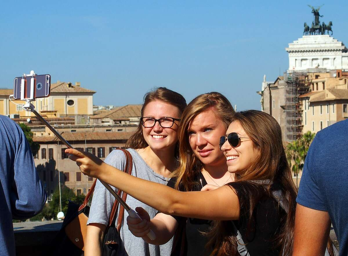 Young tourists take a selfie above the Forum in Rome.