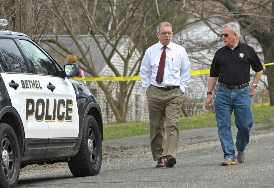 Bethel Police Chief Jeff Finch, left, and First Selectman Matt Knickerbocker walk from an investigation at the site of a shooting on Governors Lane, in Bethel, Friday afternoon. One person was dead and two others were taken to the hospital following the shooting, Friday afternoon, according Finch. March 25, 2016, in Bethel, Conn. Photo: H John Voorhees III / Hearst Connecticut Media / The News-Times