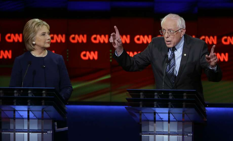 Democratic presidential candidate, Sen. Bernie Sanders, I-Vt., right, argues a point as Hillary Clinton listens during a Democratic presidential primary debate at the University of Michigan-Flint, Sunday, March 6, 2016, in Flint, Mich. Photo: Carlos Osorio, AP