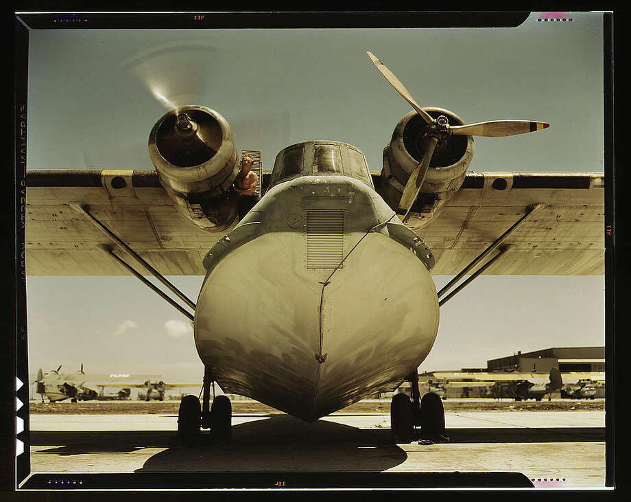 """Original caption reads: """"Plane at the Naval Air Base, Corpus Christi, Texas."""" Photo dated August 1942, by Howard R. Hollem. Photo: Farm Security Administration — Office Of War Information Collection, Library Of Congress / 2016 Public Domain"""