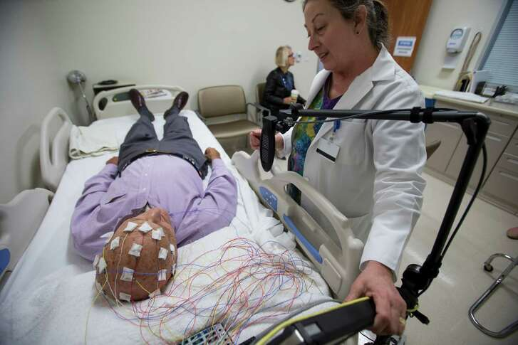 Donna Anderson, neurology technologist, right, talks to Samuel Shuman, 90, before he has an EEG done, testing for epilepsy, at Kelsey-Seybold Clinic on Wednesday, March 23, 2016, in Houston. ( Brett Coomer / Houston Chronicle )