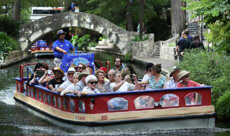 Tourists enjoy the San Antonio Riverwalk at restaurants and on the river taxis.  Leisure and hospitality employers added the most Texas jobs in February.