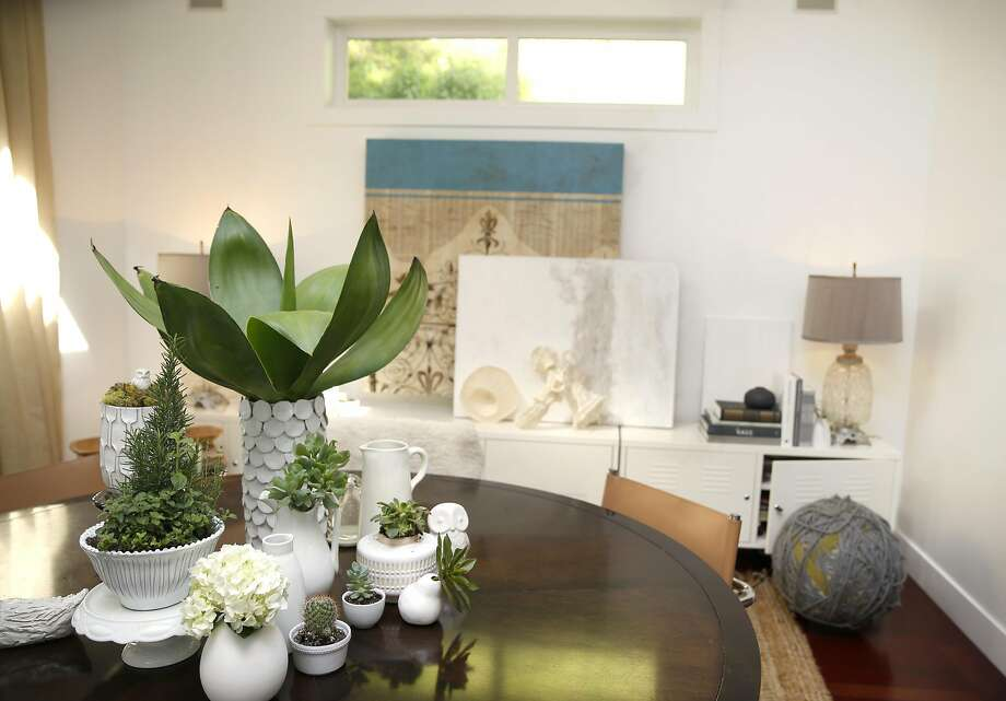Succulents on the Orlando Diaz-Azcuy dining table in Kendra Frisbie's Larkspur home. Photo: Liz Hafalia, The Chronicle