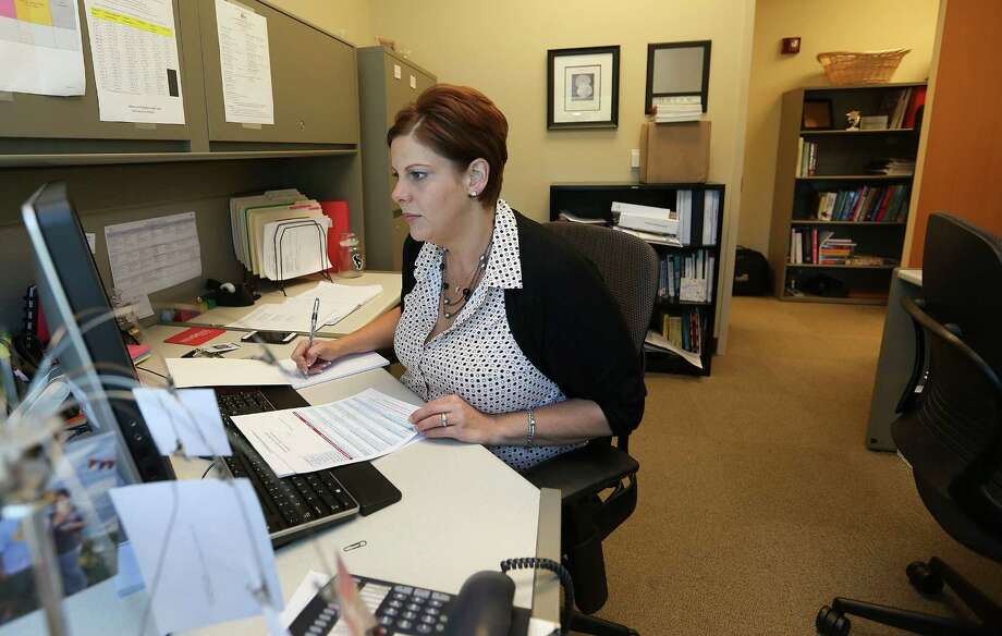 Amanda Salazar works in her office at Memorial Hermann on Friday, March 25, 2016, in Sugar Land. Salazar started working at Memorial Hermann on March 11, same day her former employer, National Oilwell Vaarco disbanded her former department. ( Elizabeth Conley / Houston Chronicle ) Photo: Elizabeth Conley, Staff / © 2016 Houston Chronicle
