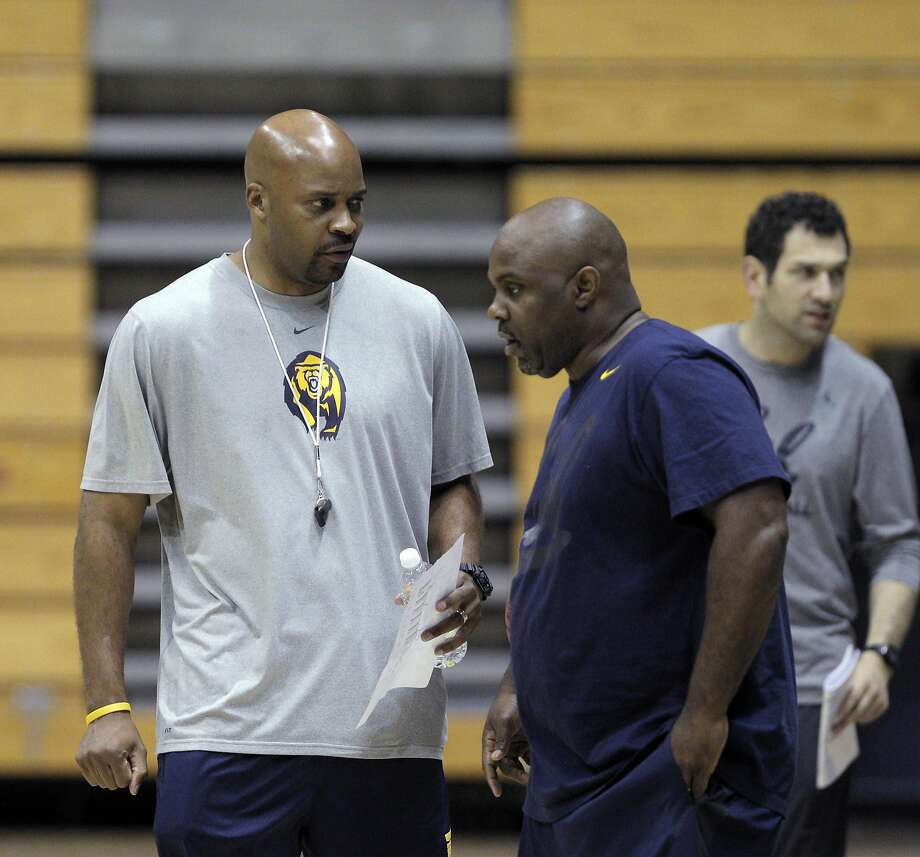 Basketball coach Cuonzo Martin chats with associate head coach Tracy Webster during the Cal men's basketball practice at Haas Pavilion in Berkeley, Calif., on Tuesday, November 11, 2014. Photo: Carlos Avila Gonzalez, The Chronicle