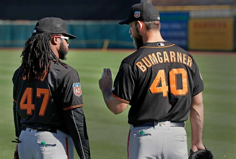 Madison Bumgarner and Johnny Cueto will pitch the first two games of the regular season in Milwaukee. Photo: Michael Macor, The Chronicle
