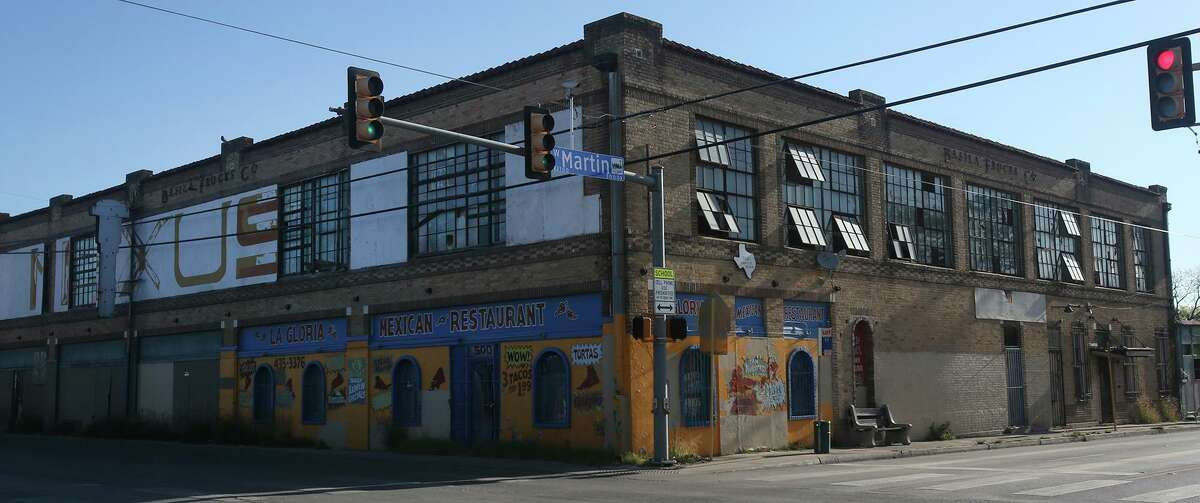 The Westside Development Corp. is seeking a partner to redevelop the Basila Frocks building.