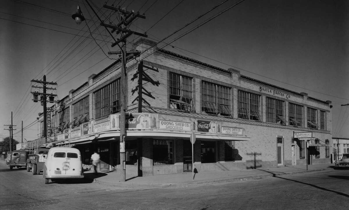 Exterior view of the Basila Frocks Co. Building, on the northeast corner of Zarzamora and Martin in 1949.