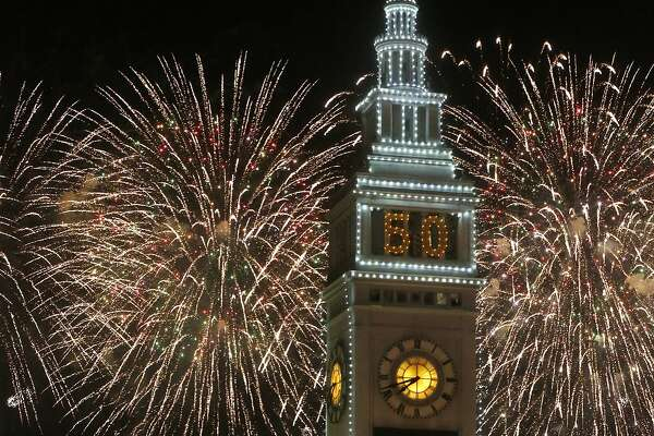 Fireworks go off behind the Ferry Building on the opening night of events for the Super Bowl City Jan. 30, 2016 in San Francisco, Calif.