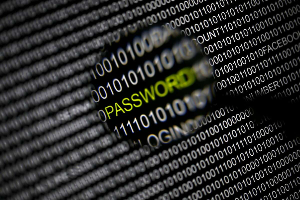 File picture illustration of the word 'password' pictured through a magnifying glass on a computer screen, taken in Berlin May 21, 2013. Security experts warn there is little Internet users can do to protect themselves from the recently uncovered