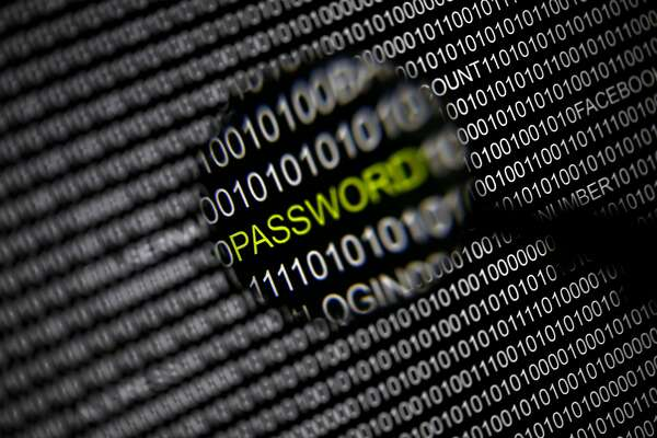 "File picture illustration of the word 'password' pictured through a magnifying glass on a computer screen, taken in Berlin May 21, 2013. Security experts warn there is little Internet users can do to protect themselves from the recently uncovered ""Heartbleed"" bug that exposes data to hackers, at least not until vulnerable websites upgrade their software. Researchers have observed April 8, 2014, sophisticated hacking groups conducting automated scans of the Internet in search of Web servers running a widely used Web encryption program known as OpenSSL that makes them vulnerable to the theft of data, including passwords, confidential communications and credit card numbers. OpenSSL is used on about two-thirds of all Web servers, but the issue has gone undetected for about two years. REUTERS/Pawel Kopczynski/Files (GERMANY - Tags: CRIME LAW SCIENCE TECHNOLOGY)"