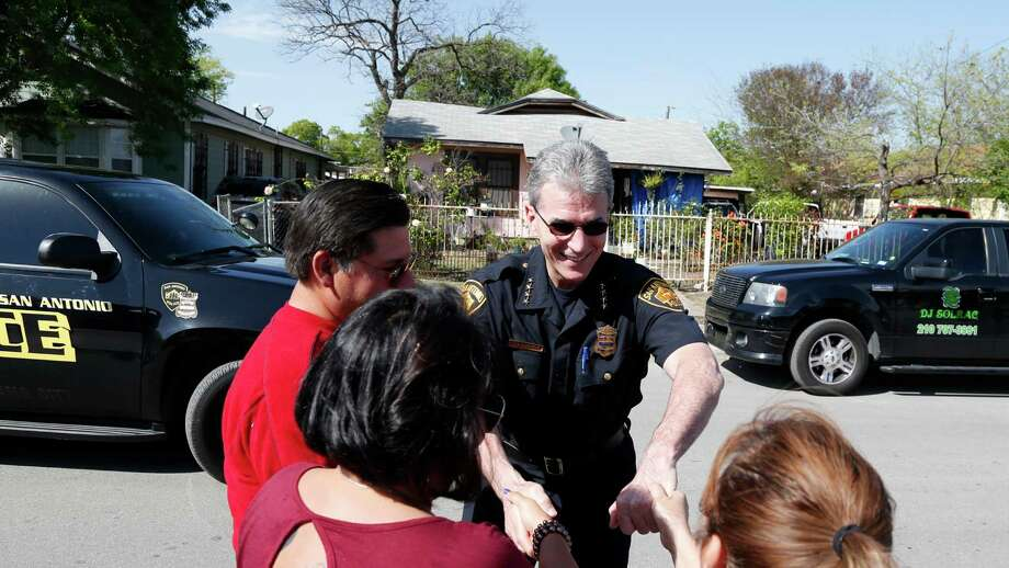 San Antonio police chief William McManus greets member of the congregation that were  doing a block walk in a West side neighborhood 24 hours after a vote of no confidence by the San Antonio Police Officers Association. Photos taken on Wednesday, March 25, 2016 Photo: Ronald Cortes, Freelance / For Express News
