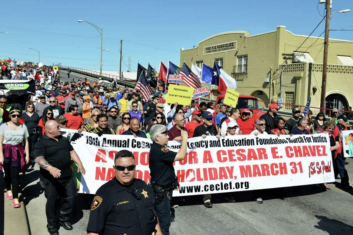 The annual Cesar Chavez march crosses over Alazan Creek in the Westside on their way to the Alamo in San Antonio, Tx. on Saturday, March 28, 2015.