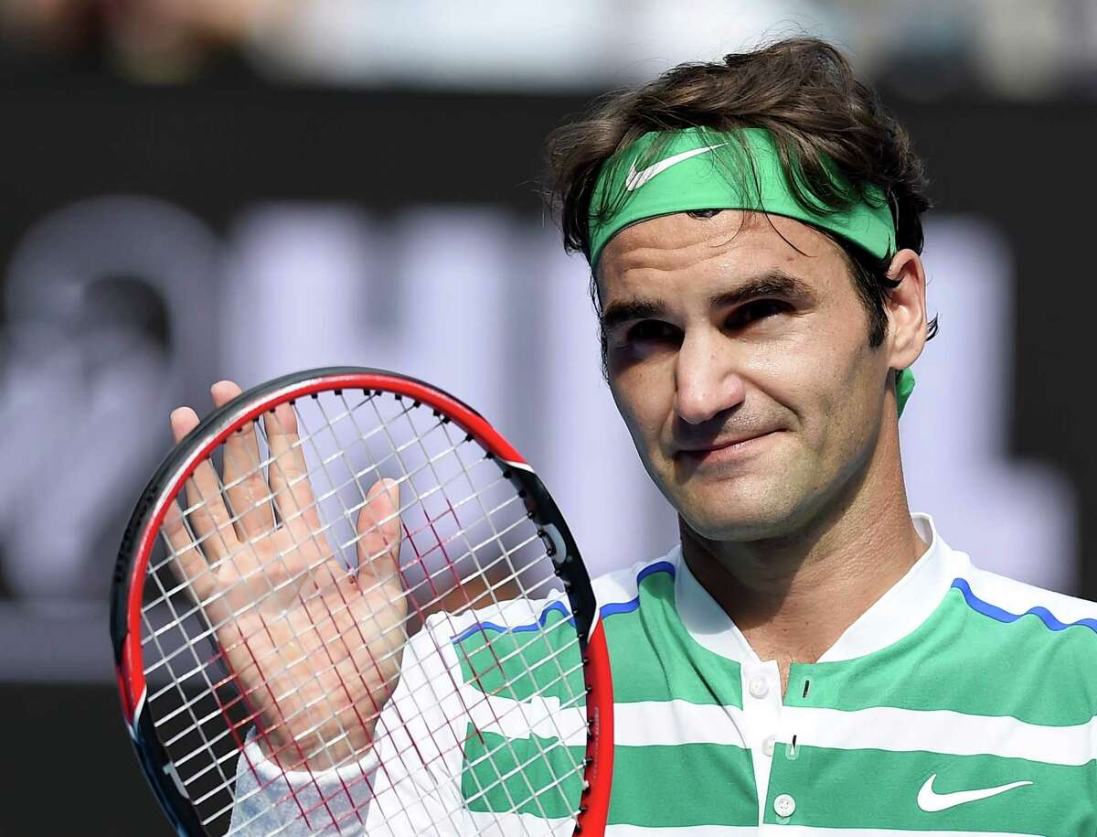 Roger Federer of Switzerland celebrates after defeating Tomas Berdych of the Czech Republic in their quarterfinal match at the Australian Open tennis championships in Melbourne, Australia, Tuesday, Jan. 26, 2016.(AP Photo/Andrew Brownbill) ORG XMIT: XMEL312