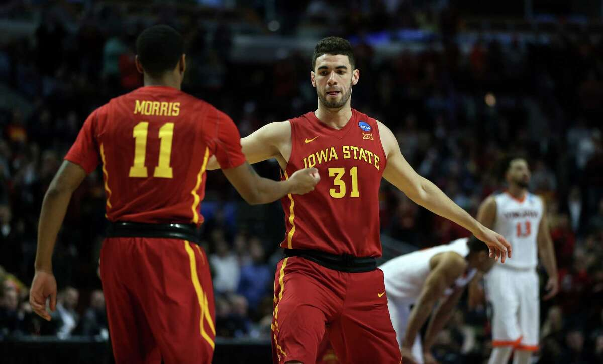 Iowa State's Monte Morris (11) and Georges Niang (31) get pumped before taking on Virginia in a Sweet 16 matchup of the NCAA Tournament's Midwest region at the United Center in Chicago on Friday, March 25, 2016. Virginia advanced, 84-71.