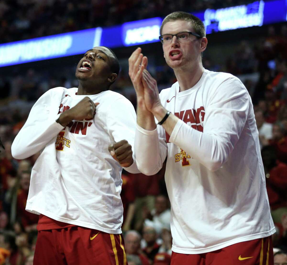 The Iowa State bench reacts during a surge against Virginia in a Sweet 16 matchup of the NCAA Tournament's Midwest region at the United Center in Chicago on Friday, March 25, 2016. Virginia advanced, 84-71.