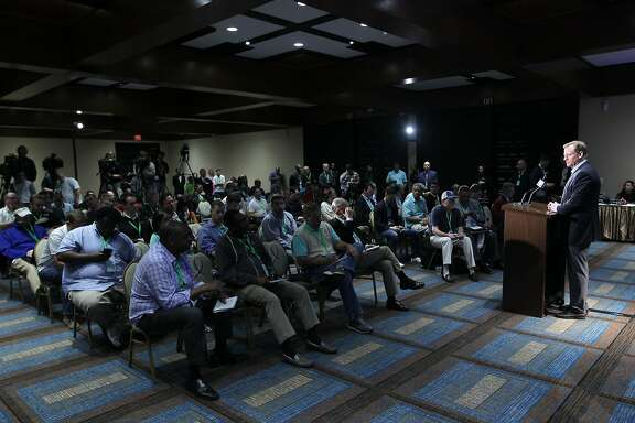 NFL Commissioner Roger Goodell, right, listens to a question from a member of the media during a press conference at the NFL owners meeting in Boca Raton, Fla., Wednesday, March 23, 2016. (AP Photo/Luis M. Alvarez)