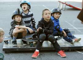 Left to right--Austin, Javier, Henry Martin, and Emilio Beltran take a skateboarding class called Shred 'n' Butter offered by San Francisco Recreation & Parks at in San Francisco, California, on friday, march 25, 2016.