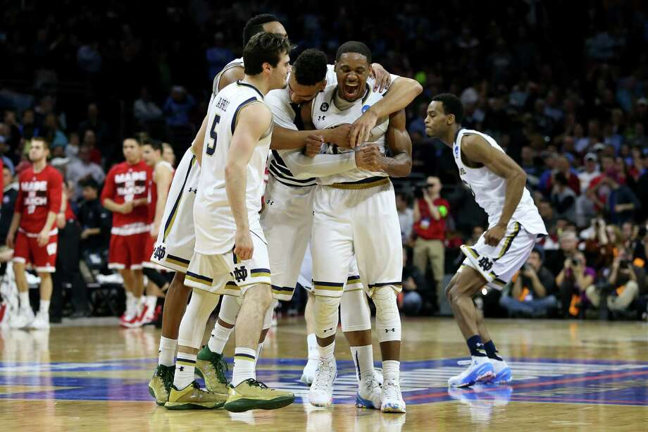 PHILADELPHIA, PA - MARCH 25:  Demetrius Jackson #11 of the Notre Dame Fighting Irish celebrate with his teammates after defeating the Wisconsin Badgers with a score of 56 to 61 during the 2016 NCAA Men's Basketball Tournament East Regional at Wells Fargo Center on March 25, 2016 in Philadelphia, Pennsylvania. Photo: Streeter Lecka, Getty Images / 2016 Getty Images