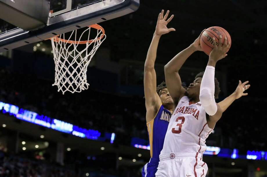 Oklahoma guard and Bellaire product Christian James (3) was a key contributor in the Sooners' 77-63 win over Texas A&M in the Sweet 16, scoring 12 points in 28 minutes off the bench. Photo: Tom Pennington, Staff / 2016 Getty Images