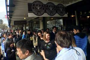 The customary line outside Starbucks' first store in Pike Place Market. (Jake Ellison / Seattle.com)