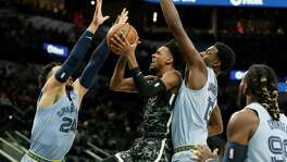 San Antonio Spurs guard Manu Ginobili (20) and Memphis Grizzlies guard Vince Carter (15) battle for a loose ball during the first half of Game 5 in a first-round NBA basketball playoff series, Tuesday, April 25, 2017, in San Antonio. (AP Photo/Eric Gay)