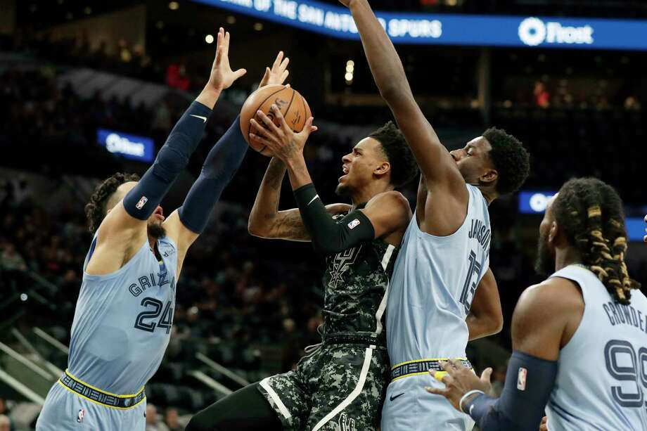 San Antonio Spurs forward LaMarcus Aldridge (12) celebrates a score with a teammate during the second half of an NBA basketball game against the Memphis Grizzlies, Monday, March 5, 2018, in San Antonio. (AP Photo/Eric Gay) Photo: Eric Gay, Associated Press / Copyright 2018 The Associated Press. All rights reserved.