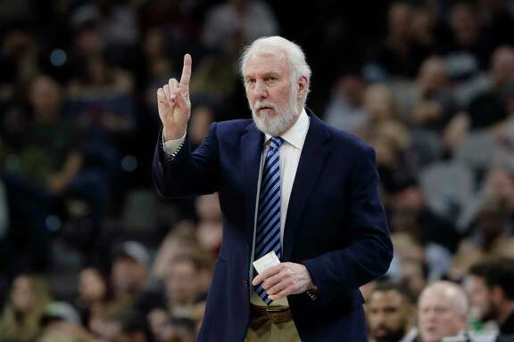 San Antonio Spurs head coach Gregg Popovich signals to his players during the second half of an NBA basketball game against the Memphis Grizzlies, Monday, March 5, 2018, in San Antonio. (AP Photo/Eric Gay)