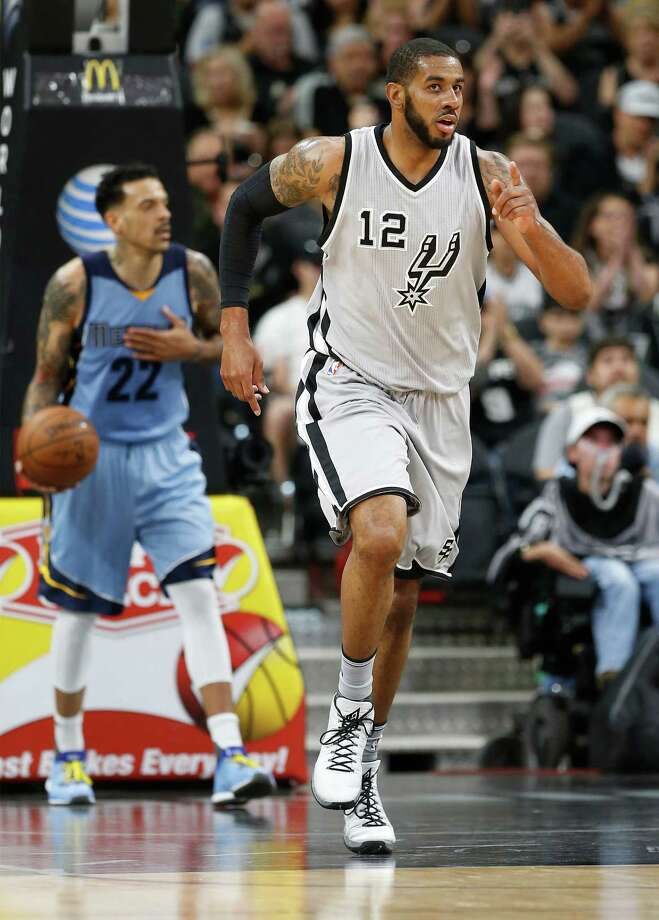 Spurs' LaMarcus Aldridge (12) gestures after scoring against the Memphis Grizzlies at the AT&T Center on Friday, Mar. 25, 2016. (Kin Man Hui/San Antonio Express-News) Photo: Kin Man Hui, Staff / San Antonio Express-News / ©2016 San Antonio Express-News