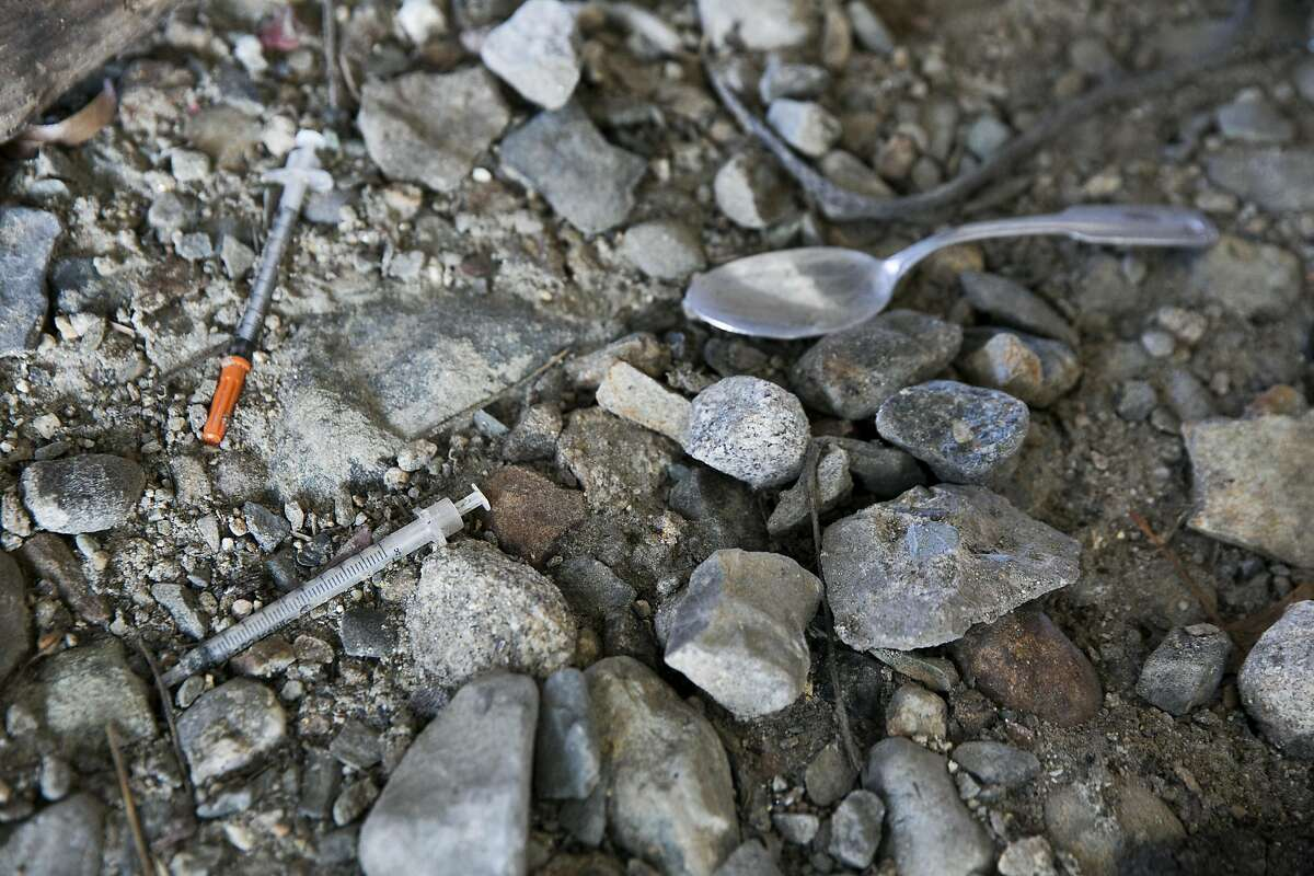 Needles scattered along the ground in a homeless encampment in Lawrence, Mass., March 12, 2016. Fentanyl, a potent and lethal cousin to heroin, is becoming the drug of choice for some addicts � and is killing them more quickly. (Katherine Taylor/The New York Times)