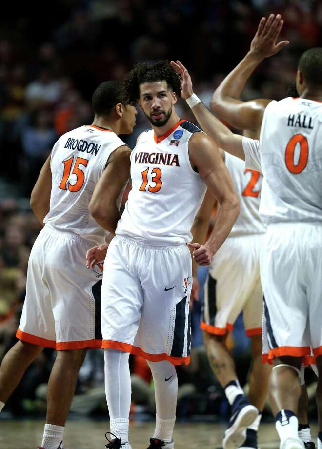 Virginia's Anthony Gill (13) celebrates with his teammates in the second half against Iowa State in a Sweet 16 matchup of the NCAA Tournament's Midwest region at the United Center in Chicago on Friday, March 25, 2016. Virginia advanced, 84-71. Photo: Chris Sweda, TNS / Chicago Tribune