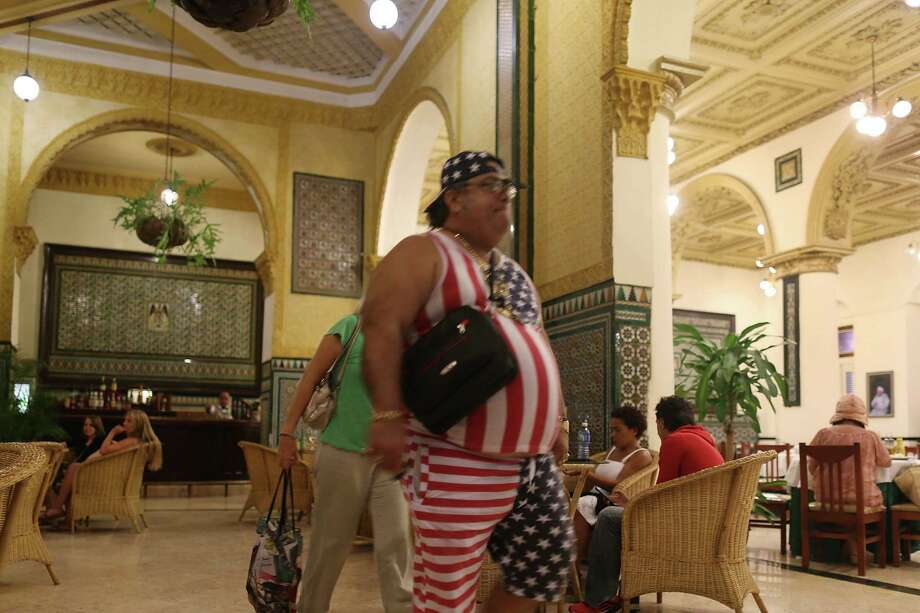 A man shows his patriotic colors as he walks March 23, 2016 in lobby of the Hotel Inglaterra in Havana, Cuba. Days before, Stamford, Conn.-based Starwood Hotels & Resorts Worldwide said it will be investing in the property as the U.S. government eases some economic restrictions. (Photo by Joe Raedle/Getty Images) Photo: Joe Raedle / Getty Images / 2016 Getty Images