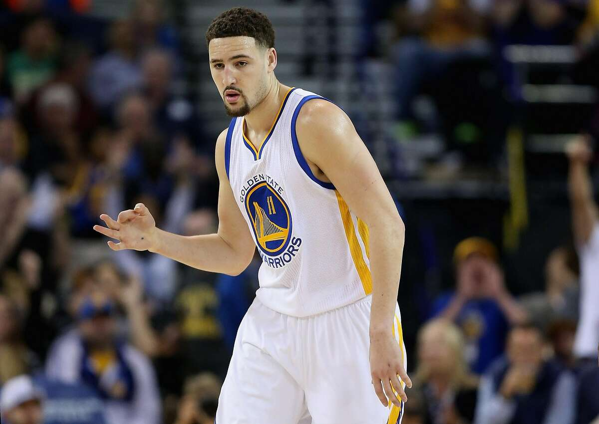 Klay Thompson #11 of the Golden State Warriors reacts after making a three-point basket against the Dallas Mavericks at ORACLE Arena on March 25, 2016 in Oakland, California.