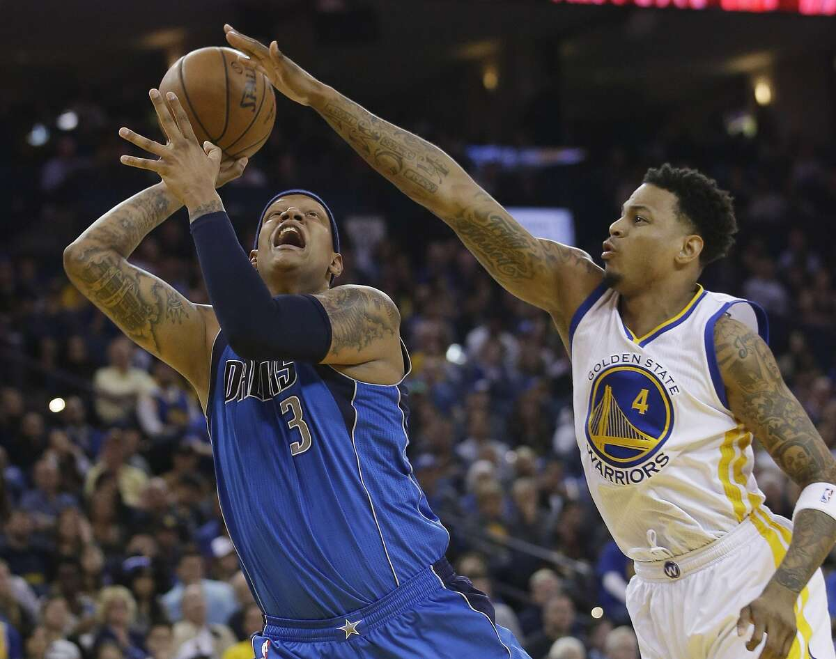Dallas Mavericks' Charlie Villanueva (3) goes up for a shot as Golden State Warriors' Brandon Rush (4) defends during the first half of an NBA basketball game Friday, March 25, 2016, in Oakland, Calif. (AP Photo/Marcio Jose Sanchez)