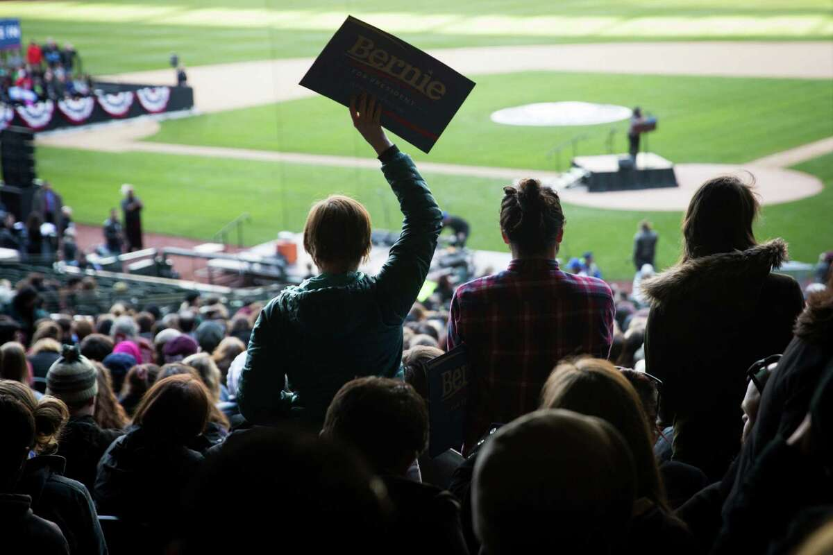 Democratic presidential candidate Bernie Sanders supporters wait for a rally to begin at Safeco Field on Friday, Mar. 25, 2016. Washington's democratic caucus takes place Saturday morning.