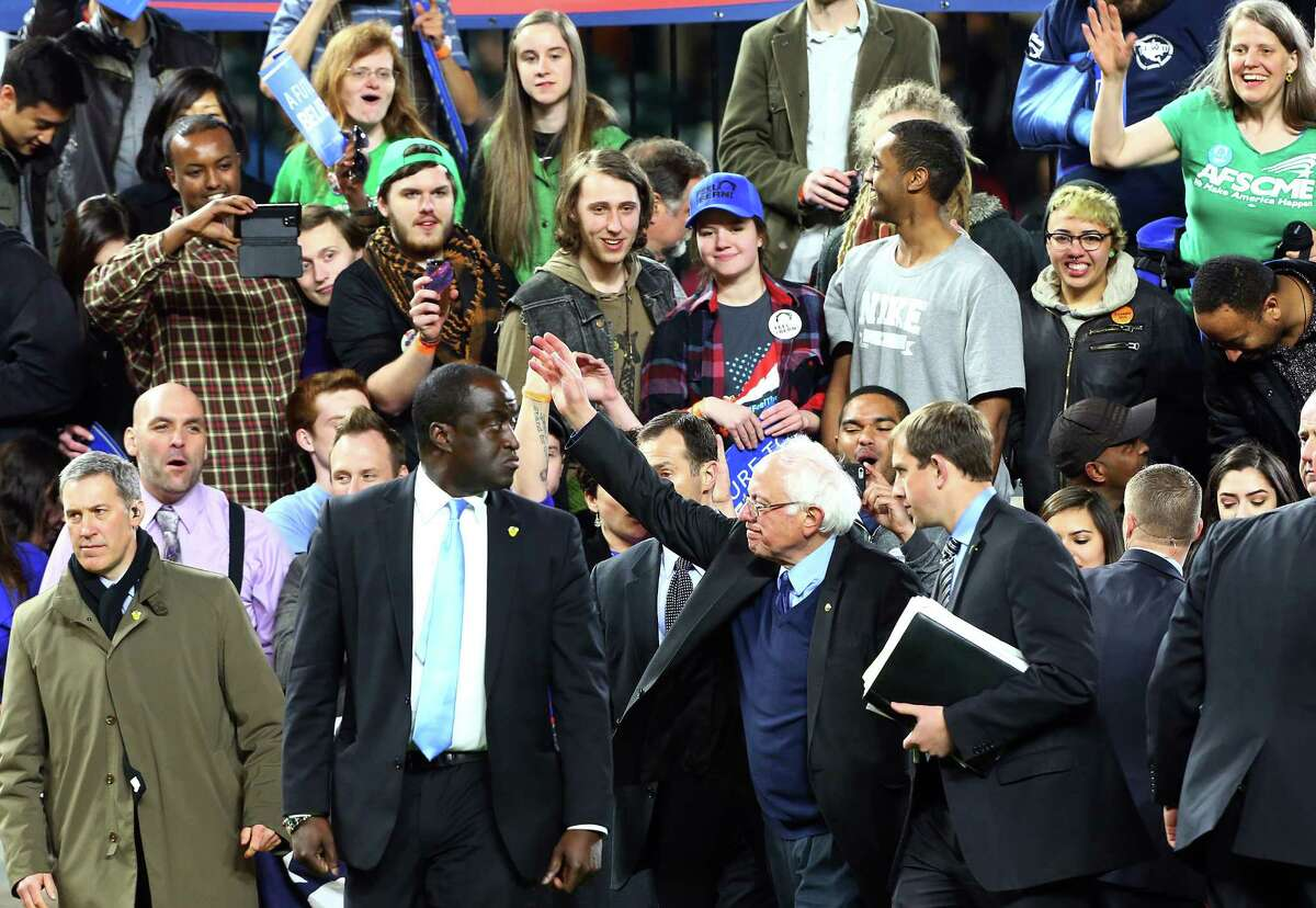 Bernie Sanders waves to fans as he leaves the field after a rally at Safeco Field, Friday, Mar. 25, 2016.