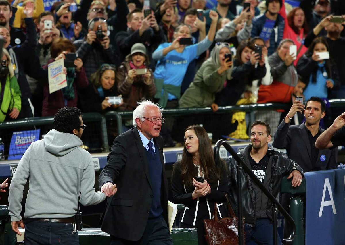 Democratic presidential candidate Bernie Sanders takes the field at Safeco for a rally, Friday, Mar. 25, 2016. He's fading four years later, especially after recent heart attack.