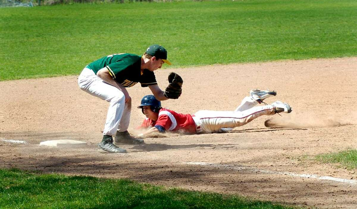 McMahon's Brian Daniello slides into 3rd base as Trinity's RJ Calo tags him out during Brien McMahon vs Trinity Catholic High School baseball at Trinity in Stamford, Conn. on Monday April 12, 2010.