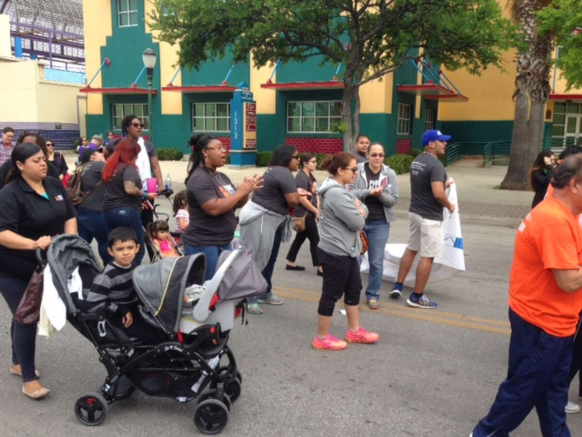 Participants march through San Antonio for the 20th March for Justice, Saturday, March 26, 2016.