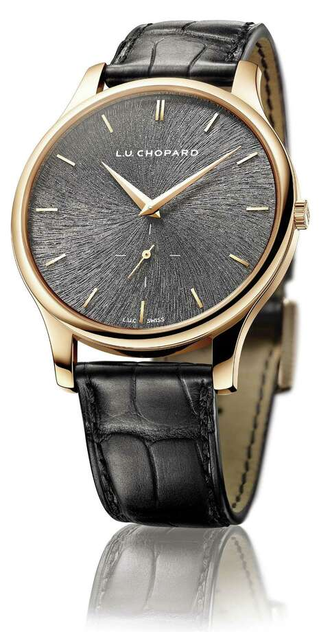 Chopard's L.U.C. XPS Fairmined watch presents ethical and elegant luxury with a meteorite dial in a sleek, slate gray.