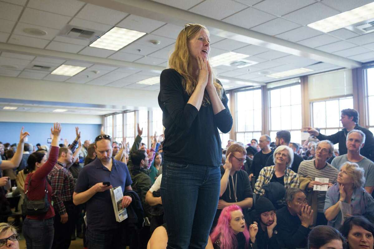 Jennifer Butte-Dahl talks to her precinct about why they should support democratic presidential candidate Hillary Clinton, during the democratic caucus at Seattle's Tops K-8 School on Saturday, Mar. 26, 2016.