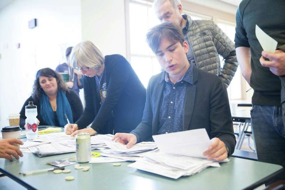 Precinct coordinator Timmy Bendis counts votes during the Democratic presidential caucus at Tops K-8 School on Saturday, Mar. 26, 2016. Photo: GRANT HINDSLEY, SEATTLEPI.COM / SEATTLEPI.COM