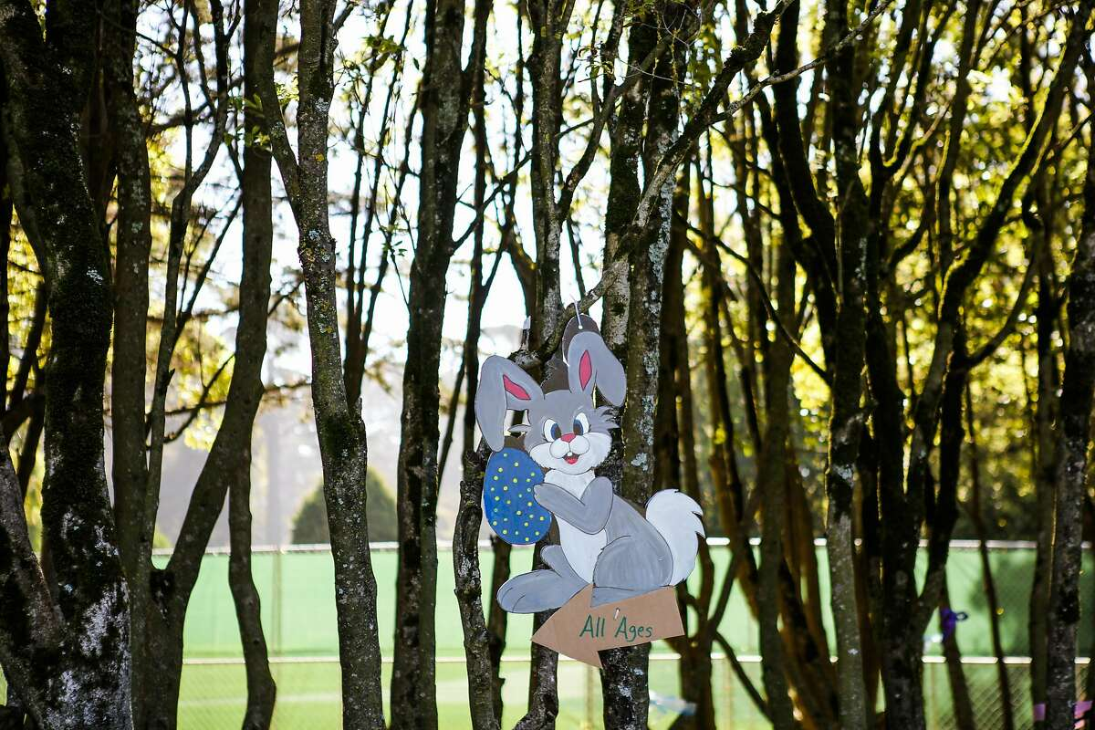 An easter bunny sign points the way to an easter egg hunt at the annual Easter Festival in Golden Gate Park, in San Francisco, California, on Saturday, March 26, 2016.