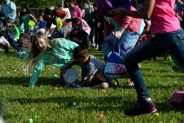 Children rush to find eggs during an Easter event hosted by Nederland's First Baptist Church at C. Doornbos Park on Saturday morning.  Photo taken Saturday 3/26/16 Ryan Pelham/The Enterprise