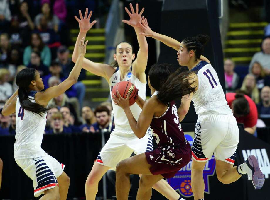 UConn's Moriah Jefferson, left, Breanna Stewart and Kia Nurse, right, surround Mississippi State's Victoria Vivians during NCAA Division I Women's Basketball Championship action at the Arena at Harbor Yard in Bridgeport, Conn., on Saturday March 26, 2016. Photo: Christian Abraham / Hearst Connecticut Media / Connecticut Post