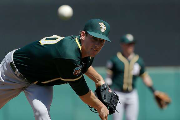 Oakland Athletics starting pitcher Chris Bassitt (40) throws before the first inning of a spring training baseball game against the San Francisco Giants in Scottsdale, Ariz., Monday, March 21, 2016. (AP Photo/Jeff Chiu)