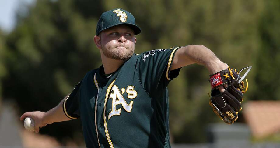 Jesse Hahn, 32 throws during Oakland Athletics spring training workouts at the Lew Wolff Training Complex in Mesa, Arizona on  Saturday February 27, 2016. Photo: Michael Macor, The Chronicle